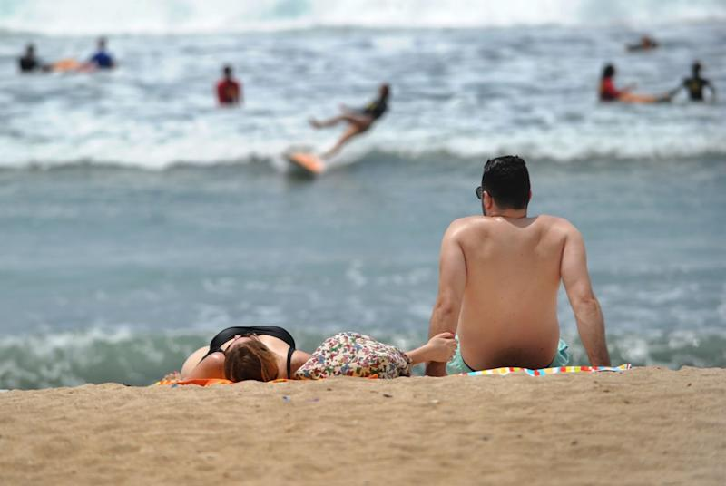 Bali, which is popular among tourists, is known for its beaches and some people argued the G-string bikini would offend the locals. Pictured is a stock image of people lying on the beach.