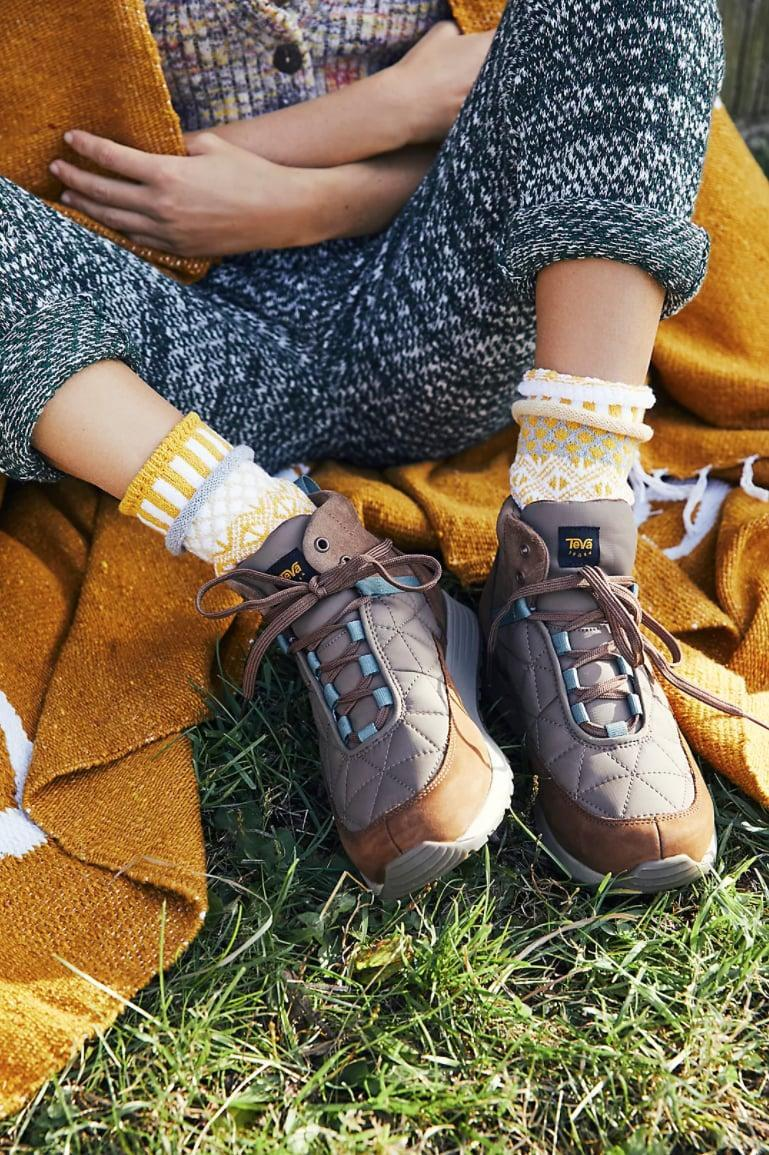 <p>In 2020, hiking boots inspired our urge to mix fashion with function. Exploring the great outdoors became somewhat of an Instagram aesthetic. But with the craze for Bottega Veneta's new Puddle Boot and similar weatherproof options you might even wear in the snow, it's safe to say the details on these boots don't just make them eye-catching, perfectly rugged, and optimal for pairing with cozy socks, but also durable.</p> <p><span>Teva Ember Commute Mid Boots</span> ($140)</p>