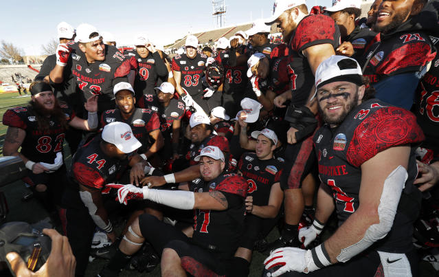 San Diego State football players celebrate after they beat Central Michigan in the New Mexico Bowl NCAA college football game on Saturday, Dec. 21, 2019 in Albuquerque, N.M. (AP Photo/Andres Leighton)