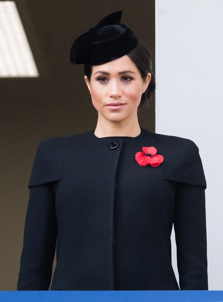 <p>For her debut Remembrance Service in London, Meghan wore a bespoke outfit by Givenchy. She finished the all-black ensemble with a co-ordinating headpiece and poppy. <em>[Photo: Getty]</em> </p>