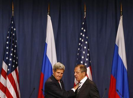 U.S. Secretary of State John Kerry and Russian Foreign Minister Sergei Lavrov (R) shake hands after making statements following meetings regarding Syria, at a news conference in Geneva September 14, 2013. REUTERS/Ruben Sprich