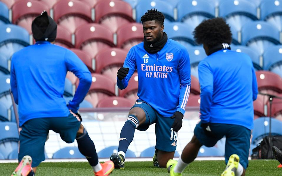 Arsenal's Thomas Partey, center, warms up before the English Premier League soccer match - EPA