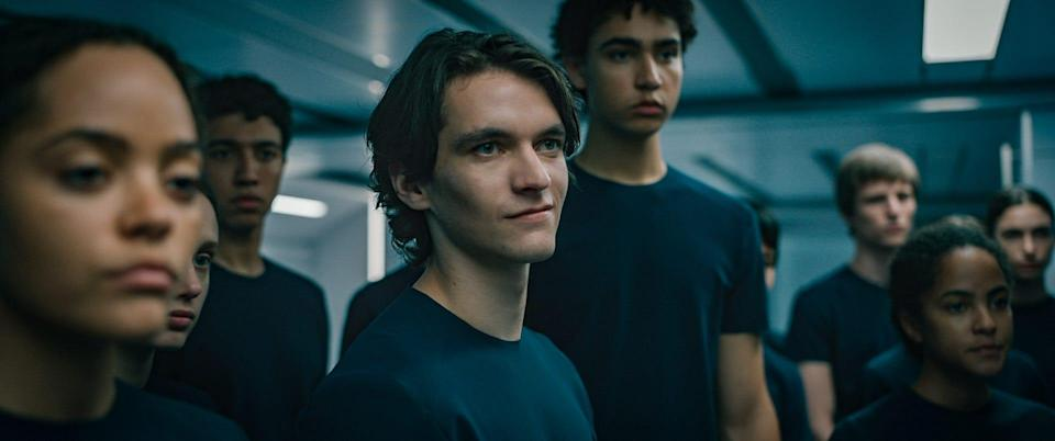 "Zac (Fionn Whitehead, center) sees a chance to grab power on the ship and takes it in ""Voyagers."""