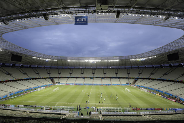 Mexican players exercise during an official training session, the day before the group A World Cup soccer match between Brazil and Mexico, at the Arena Castelao in Fortaleza, Brazil, Monday, June 16, 2014. (AP Photo/Andre Penner)