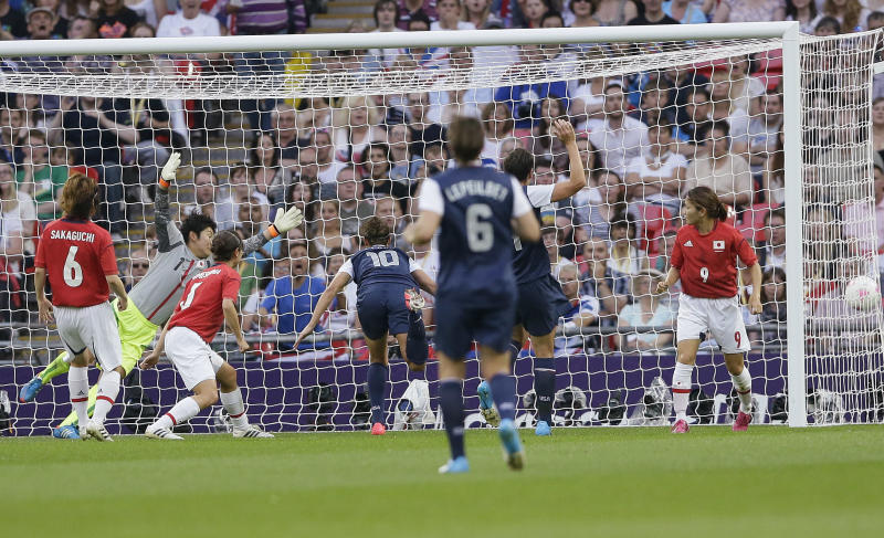 United States' Carli Lloyd (10) scores against Japan during the women's soccer gold medal match at the 2012 Summer Olympics, Thursday, Aug. 9, 2012, in London. (AP Photo/Kirsty Wigglesworth)