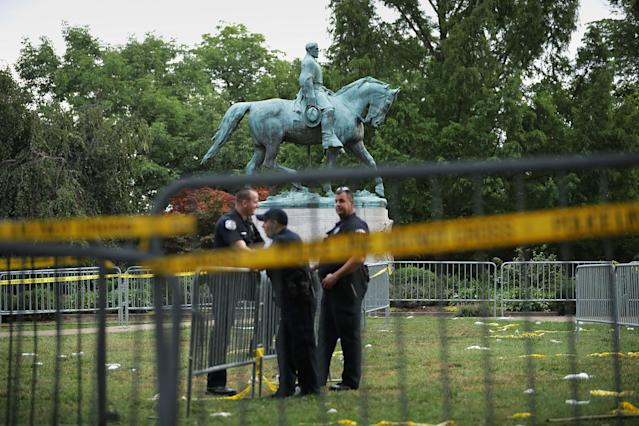 <p>Police stand watch near the statue of Confederate Gen. Robert E. Lee in the center of Emancipation Park the day after the Unite the Right rally devolved into violence Aug.13, 2017 in Charlottesville, Va. The Charlottesville City Council voted to remove the statue and change the name of the space from Lee Park to Emancipation Park, sparking protests from white nationalists, neo-Nazis, the Ku Klux Klan and members of the 'alt-right.' (Photo: Chip Somodevilla/Getty Images) </p>