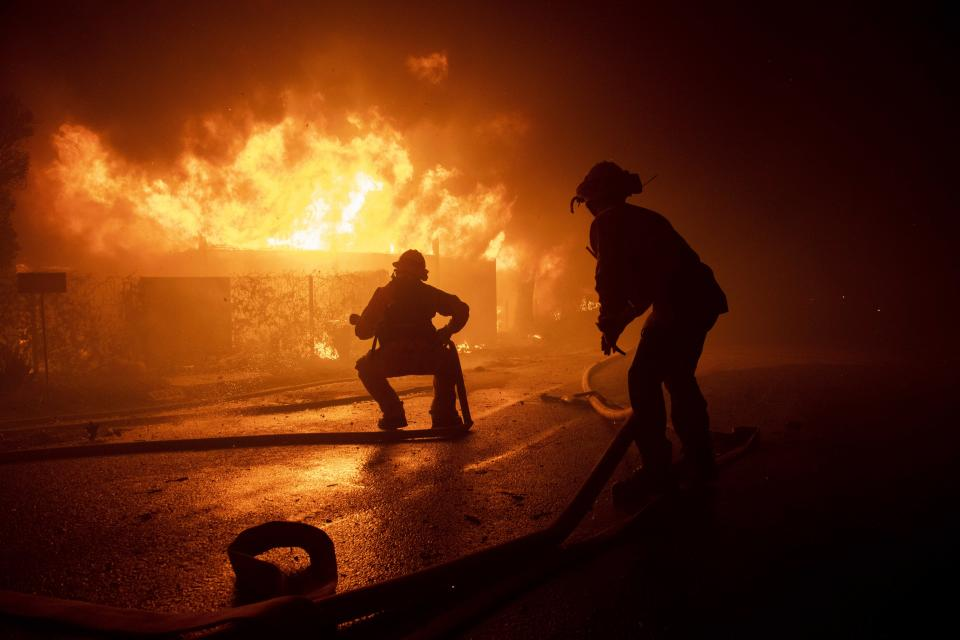 Firefighters try to save a home on Tigertail Road during the Getty fire, Oct. 28, 2019, in Los Angeles, Calif. (Photo: Christian Monterrosa/AP)