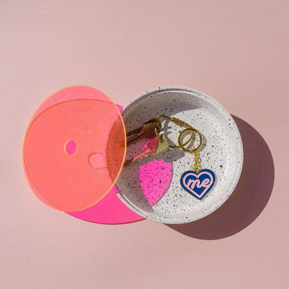 """If your girlfriend always puts others before herself, remind her of the importance of self-care with this cute key chain from Pepper. $7, Pepper. <a href=""""https://www.wearpepper.com/products/heart-me-keychain"""">Get it now!</a>"""