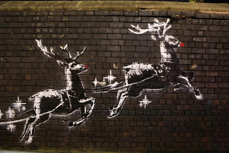 A Banksy reindeer mural in Birmingham has been defaced with red noses (Picture: SWNS)