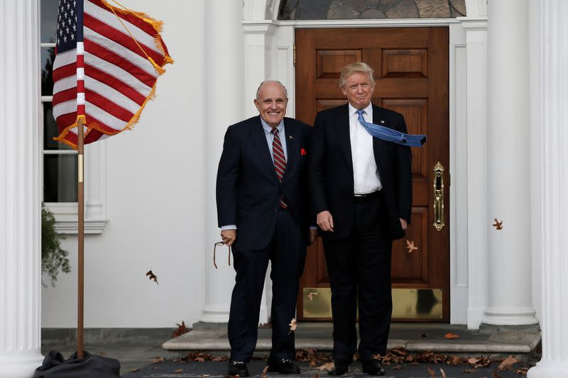U.S. President-elect Donald Trump stands with former New York City Mayor Rudolph Giuliani before their meeting at Trump National Golf Club in Bedminster