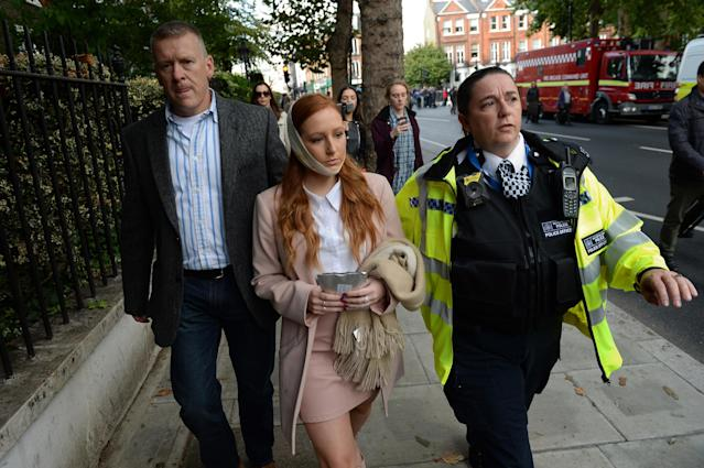 <p>A police officer escorts an injured woman from the scene at Parsons Green Underground Station on September 15, 2017 in London, England. (Photo: Chris J Ratcliffe/Getty Images) </p>