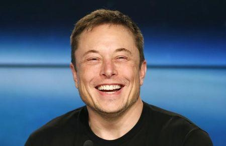 FILE PHOTO: SpaceX founder Musk smiles at a press conference following the first launch of a SpaceX Falcon Heavy rocket in Cape Canaveral