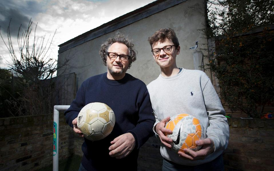 Author James Brown and his son Marlais share a love of football - Jeff GIlbert