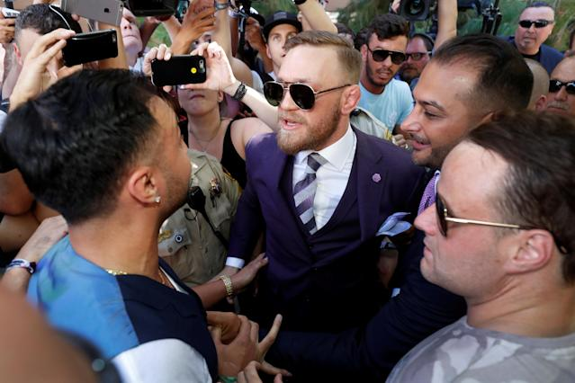 UFC lightweight champion Conor McGregor (C) of Ireland has words with former sparring partner Paulie Malignaggi (L) after his arrival at Toshiba Plaza in Las Vegas, Nevada U.S. on August 22, 2017. (Reuters)