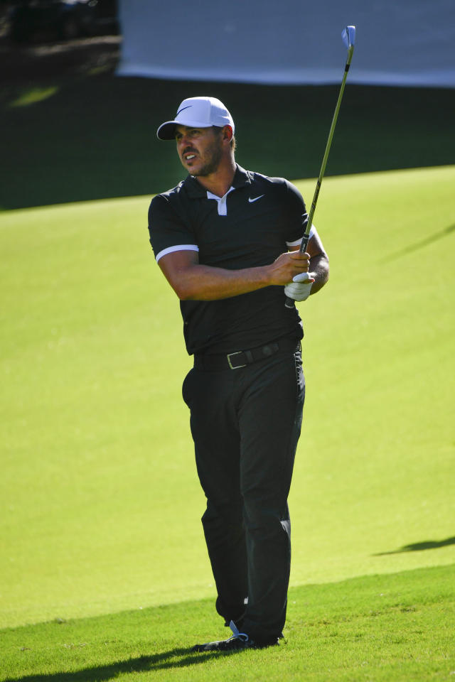 Brooks Koepka watches his shot to the 18th green during the first round of the Tour Championship golf tournament Thursday, Aug. 22, 2019, in Atlanta. Koepka ended the day tied for the lead with Xander Schauffele and Justin Thomas at 10 under par. (AP Photo/John Amis)