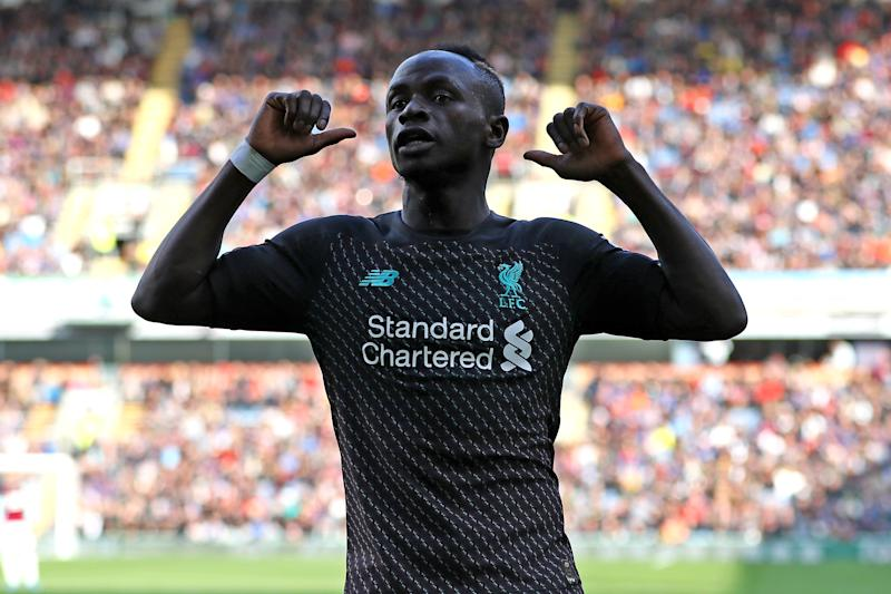 BURNLEY, ENGLAND - AUGUST 31: Sadio Mane of Liverpool celebrates after their team scores a goal during the Premier League match between Burnley FC and Liverpool FC at Turf Moor on August 31, 2019 in Burnley, United Kingdom. (Photo by Matthew Lewis/Getty Images)