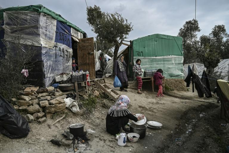 Rights groups and medical charities have repeatedly criticised living conditions at the camps (AFP Photo/ARIS MESSINIS)
