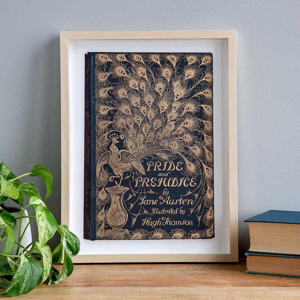 <p>This <span>First Edition Book Cover Art Print</span> ($65) is such a gorgeous addition to their space.</p>