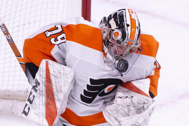 Philadelphia Flyers goaltender Carter Hart eyes the puck as he makes a save during the first period of an NHL hockey game against the Montreal Canadiens on Thursday, Feb. 21, 2019, in Montreal. (Paul Chiasson/The Canadian Press via AP)