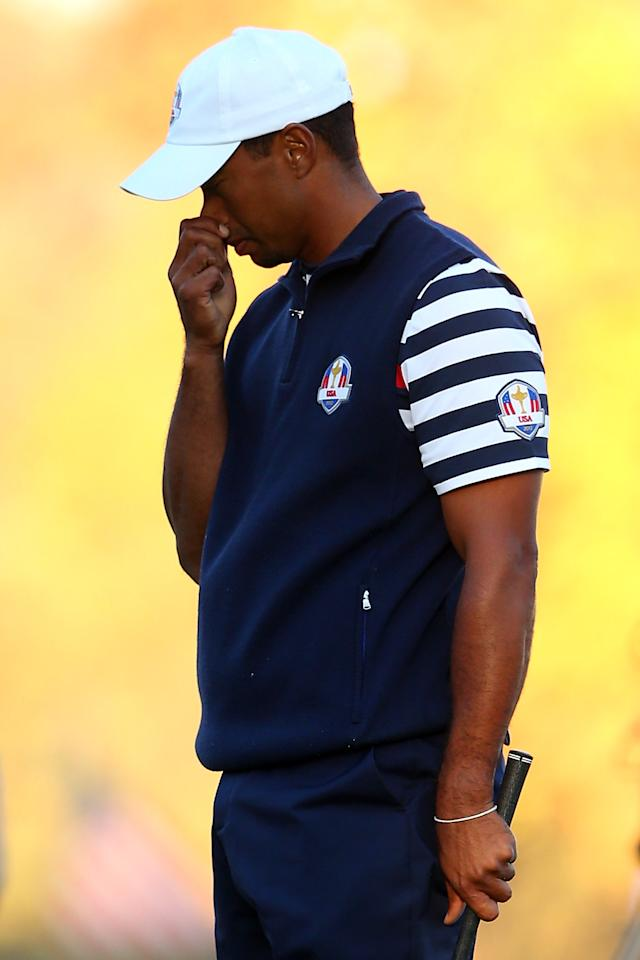 MEDINAH, IL - SEPTEMBER 30:  Tiger Woods of the USA reacts to a shot during the Singles Matches for The 39th Ryder Cup at Medinah Country Club on September 30, 2012 in Medinah, Illinois.  (Photo by Mike Ehrmann/Getty Images)