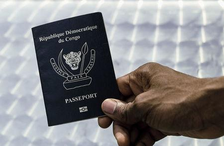 An immigration official displays a Congolese biometric passport in the Democratic Republic of Congo's capital Kinshasa