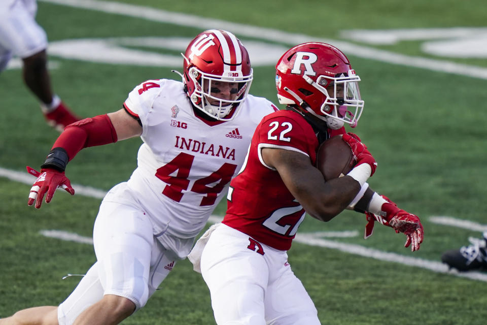 Indiana linebacker Thomas Allen (44) pursues Rutgers running back Kay'Ron Adams (22) during the second quarter of an NCAA college football game Saturday, Oct. 31, 2020, in Piscataway, N.J. (AP Photo/Corey Sipkin)