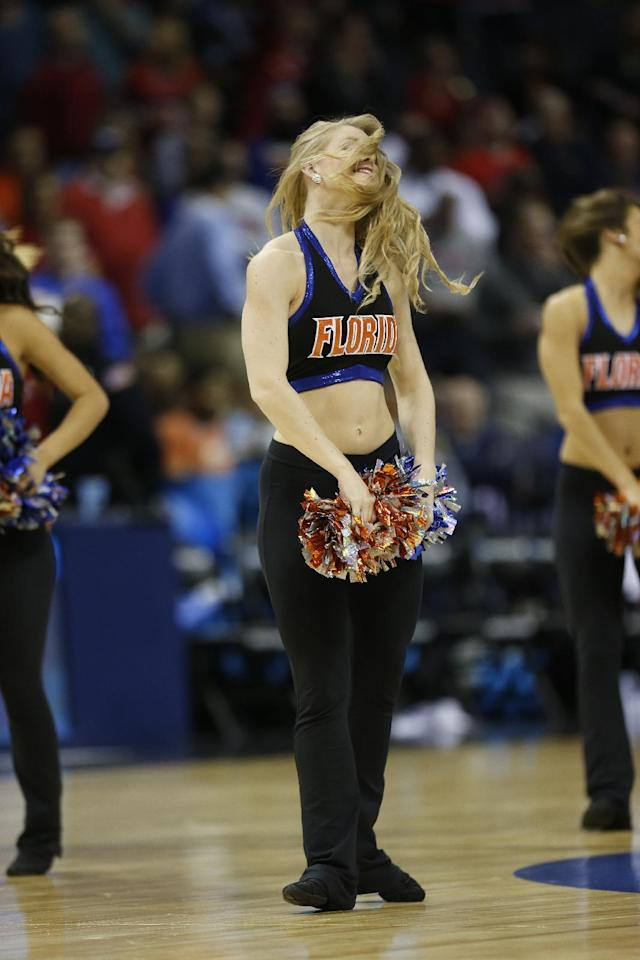 Florida cheerleaders perform against Dayton during the first half in a regional final game at the NCAA college basketball tournament, Saturday, March 29, 2014, in Memphis, Tenn. (AP Photo/John Bazemore)