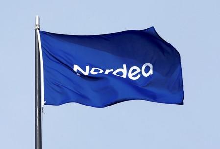 FILE PHOTO: A flag flutters over the Nordea bank headquarters in Helsinki