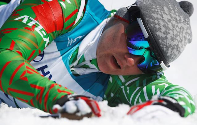 Cross-Country Skiing - Pyeongchang 2018 Winter Paralympics - Ladies' 12 KM - Sitting - Alpensia Biathlon Centre - Pyeongchang, South Korea - March 11, 2018 - Valiantsina Shyts of Belarus lies in the snow after the finish line. REUTERS/Carl Recine