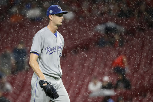 Kansas City Royals starting pitcher Eric Skoglund walks back to the dugout during a rain delay in the third inning of the team's baseball game against the Cincinnati Reds, Tuesday, Sept. 25, 2018, in Cincinnati. (AP Photo/John Minchillo)