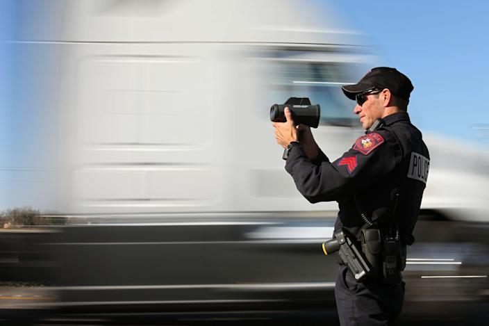 12/18/12 12:44:25 PM -- Mustang Ridge, TX, U.S.A -- Mustang Ridge Police Department Sgt. John Bennett checks speeds of vehicles on Highway 130 south of Austin, Texas. It's the fastest stretch of road in the USA: a 41-mile stretch of Highway 130 in central Texas connecting Austin to San Antonio that recently raised its speed limit to 85 mph, the highest in the country. Texas transportation officials say the newly-expanded and refurbished toll road is wide, flat and safe for such speeds. Highway safety advocates say raising the limit to 85 mph sets a dangerous precedent that other states could follow. Just three weeks after opening, the highway witnessed its first traffic fatality, bolstering the safety advocates? argument. Highway police are still investigating to determine if speed played a role in the crash that killed a Beaumont woman. Besides the controversial speed limit, Highway 130 is the state?s first ever public-private highway venture. Revenue from the toll road will be split between Texas and the SH 130 Concession Company, which expanded the road, and Texas received $25 million from the company for raising the speed limit. Higher speed limits act as an incentive for drivers to use the road. More states could be seeing this type of public-private partnership on infrastructure projects, highway safety experts say, as less money arrives from Washington. -- Photo by Erich Schlegel, Freelance ORG XMIT: ES 42827 Texas super high 12/18/ [Via MerlinFTP Drop]