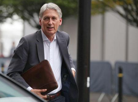 Britain's Chancellor of the Exchequer, Philip Hammond, arrives at the conference centre for the Conservative Party Conference, in Manchester