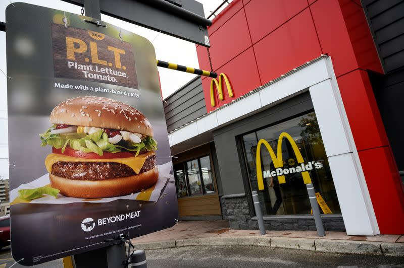 "FILE PHOTO: A sign promoting McDonald's ""PLT"" burger with a Beyond Meat plant-based patty at one of 28 test restaurant locations in London, Ontario"