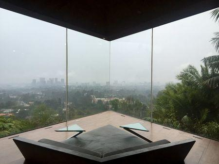 A foggy view of Downtown Los Angeles is seen from the James Goldstein residence, which was designed by modernist architect John Lautner, during a media event in Los Angeles, California February 17, 2016. REUTERS/Piya Sinha-Roy