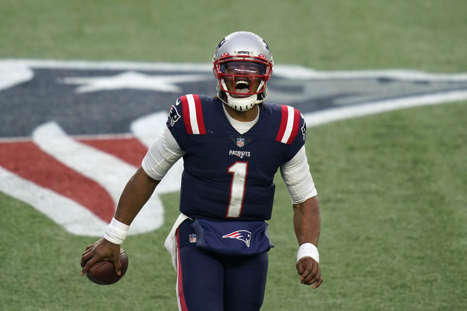FILE — New England Patriots quarterback Cam Newton celebrates his touchdown pass to Devin Asiasi in the second half of an NFL football game against the New York Jets, in this Sunday, Jan. 3, 2021 file photo, in Foxborough, Mass. The Patriots released quarterback Cam Newton on Tuesday, Aug. 31, 2021, clearing the way for rookie Mac Jones to open the season as New England's quarterback, according to a person with knowledge of the move. The person spoke to the Associated Press on condition of anonymity because the decision has not been announced. (AP Photo/Elise Amendola, File)
