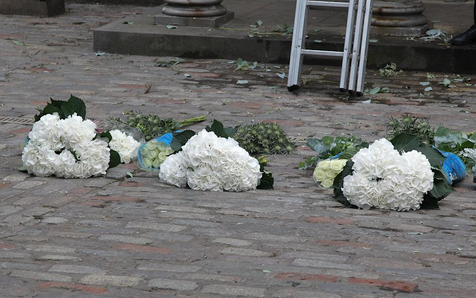EDINBURGH, SCOTLAND - JULY 30:  Flowers are bundled on the street as workers arrange them outside Canongate Kirk on the morning of the wedding of Mike Tindall and Zara Phillips on July 30, 2011 in Edinburgh, Scotland. The Queen's granddaughter Zara Phillips will marry England rugby player Mike Tindall today at Canongate Kirk. Many royals are expected to attend including the Duke and Duchess of Cambridge.  (Photo by Chris Jackson/Getty Images)
