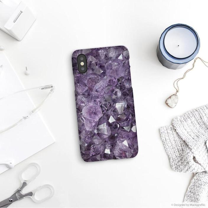 """<h2><a href=""""https://www.etsy.com/listing/490126647/crystal-phone-case-mineral-photography"""" rel=""""nofollow noopener"""" target=""""_blank"""" data-ylk=""""slk:Etsy Crystal Phone Case"""" class=""""link rapid-noclick-resp"""">Etsy Crystal Phone Case</a></h2>Sagittarians love to be one with nature. This purple crystal phone case will be sure to ground them, no matter where they are. <br> <br> <strong>Macrografiks</strong> Crystal Phone Case, $, available at <a href=""""https://www.etsy.com/listing/490126647/crystal-phone-case-mineral-photography"""" rel=""""nofollow noopener"""" target=""""_blank"""" data-ylk=""""slk:Etsy"""" class=""""link rapid-noclick-resp"""">Etsy</a>"""