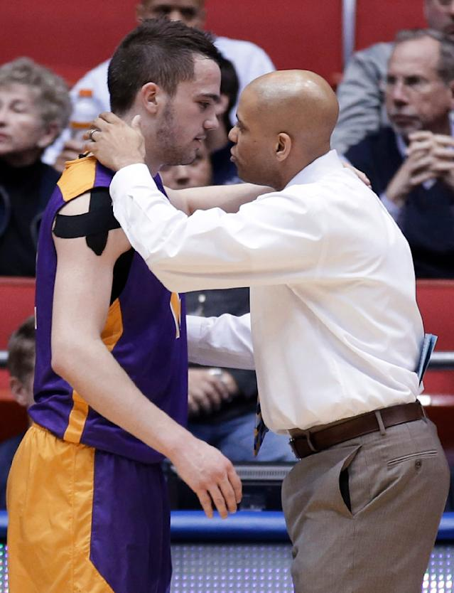 Mount St. Mary's coach Jamion Christian, right, congratulates Albany guard Peter Hooley after Albany defeated Mount St. Mary's 71-64 in a first-round game of the NCAA college basketball tournament, Tuesday, March 18, 2014, in Dayton, Ohio. (AP Photo/Al Behrman)