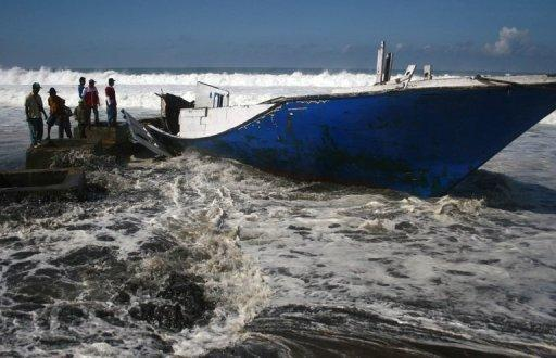 The wreckage of an asylum seekers' boat lies on the shore of Wonogoro village in East Java province in April 2012. A series of refugee boat disasters have occured in recent years, as unseaworthy, overloaded vessels packed with desperate migrants struggle to reach Australia