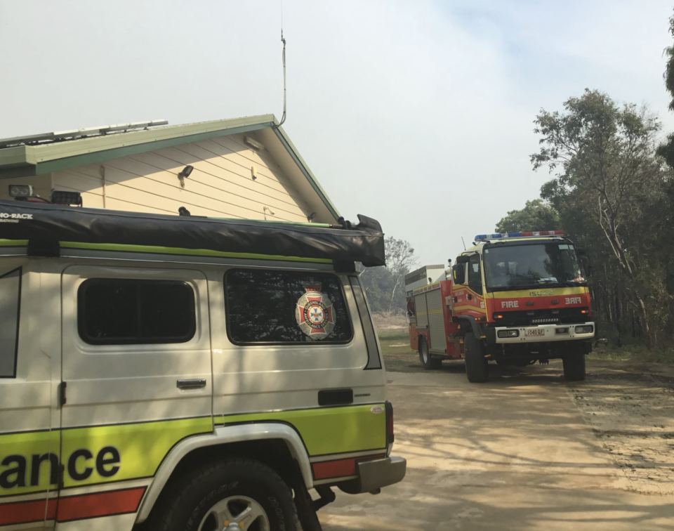 Firefighters work to save a home from the Fraser Island fire.