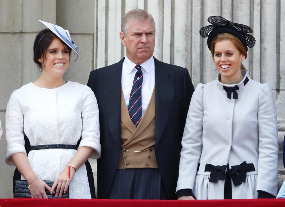Eugenie, left, with Prince Andrew and Princess Beatrice in 2013 [Photo: Getty]