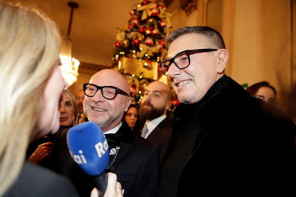 """Italian designer Domenico Dolce, left, and Stefano Gabbana arrive for the gala premiere of La Scala opera house, in Milan, Italy, Saturday, Dec. 7, 2019. Milan's storied La Scala opens its 2019-2020 season on Saturday with Puccini's """"Tosca,"""" which stars Russian soprano Anna Netrebko as the object of unwanted sexual attention from a powerful authority figure. (AP Photo/Luca Bruno) (Photo: ASSOCIATED PRESS)"""