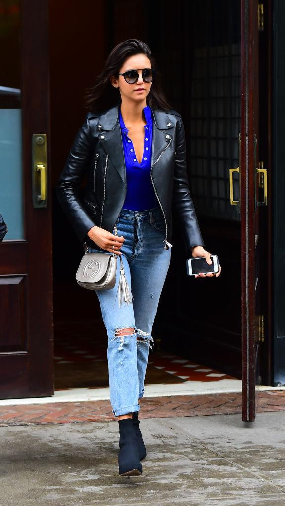<p>Nina Dobrev spotted out and about in New York City sporting a leather moto jacket, distressed denim, and Gucci bag on May 16, 2018. (Photo: Raymond Hall/GC Images) </p>