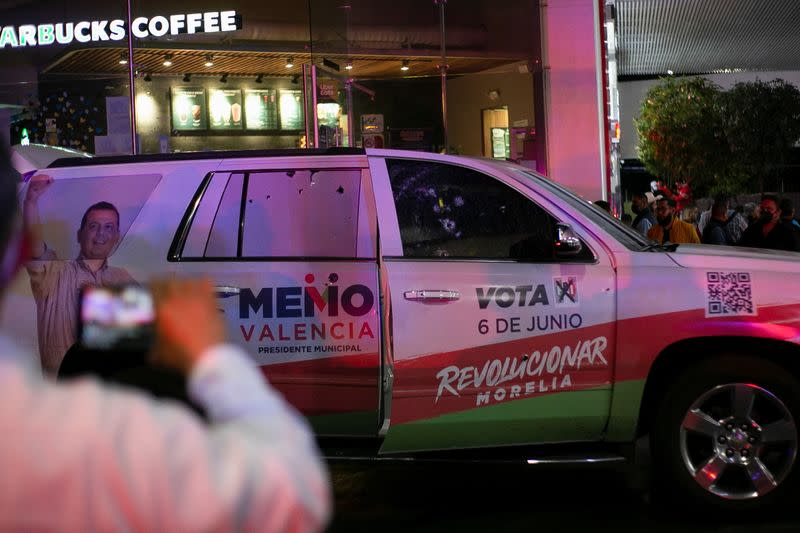 A forensic technician works at a scene where unknown assailants attacked the truck of the campaign team of Guillermo Valencia, in Morelia
