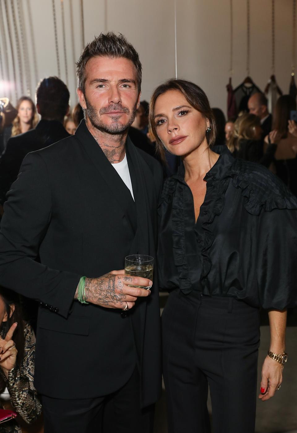 David and Victoria Beckham pose together at Victoria Beckham and Sotheby's celebration of Andy Warhol with Don Julio 1942 at her Dover Street store, on September 30, 2019 in London, England. (Photo by Darren Gerrish/WireImage for White Company)