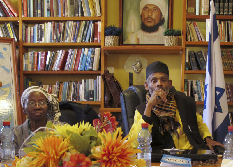 In this photo taken Tuesday, March 6, 2012, Sheik Ayed al-Abed, right, and Edya, name given, attend a meeting in the southern Israeli city of Dimona. For years, Israel's array of African communities had little interaction, divided by religious, linguistic and cultural differences that made it impossible to think about one another. But in an unprecedented gathering, some members of these communities, including Jewish Ethiopians, nomadic Muslim Arabs and migrants from Eritrea and Sudan are banding together, claiming their shared skin tone has given them a common experience of discrimination. (AP Photo/Diaa Hadid)