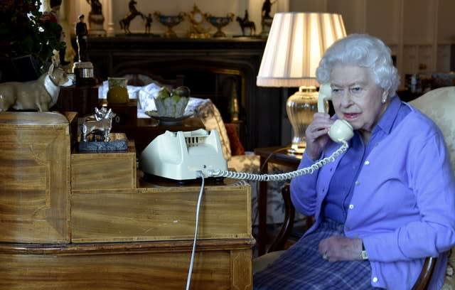 The Queen has been conducting some of her duties by phone due to the lockdown and is pictured holding her weekly audience with Prime Minister Boris Johnson. PA Media
