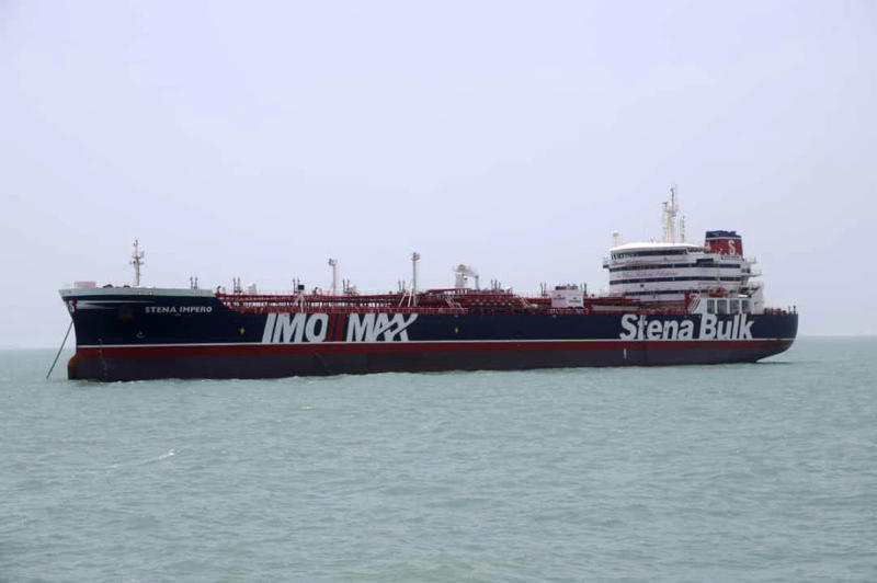 "A British-flagged oil tanker Stena Impero which was seized by the Iran's Revolutionary Guard on Friday is photographed in the Iranian port of Bandar Abbas, Saturday, July 20, 2019. The chairman of Britain's House of Commons Foreign Affairs Committee says military action to free the oil tanker seized by Iran would not be a good choice. Tom Tugendhat said Saturday it would be ""extremely unwise"" to seek a military solution to the escalating crisis, especially because the vessel has apparently been taken to a well-protected port. (Tasnim News Agency/via AP)"