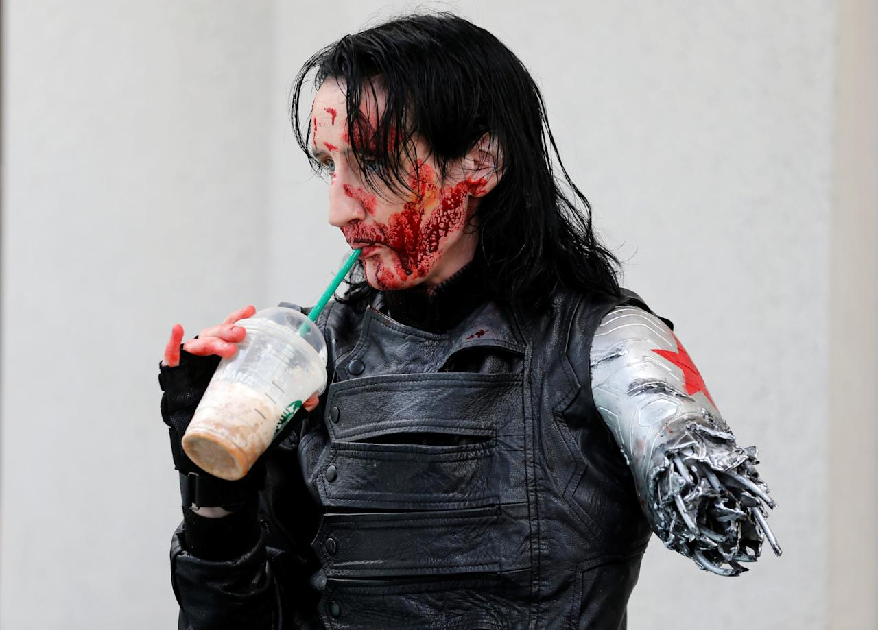 Dawn Richardson grabs a Starbucks drink in the costume of the Winter Soldier at the pop culture event Comic-Con International in San Diego, California, United States July 22, 2016.    REUTERS/Mike Blake