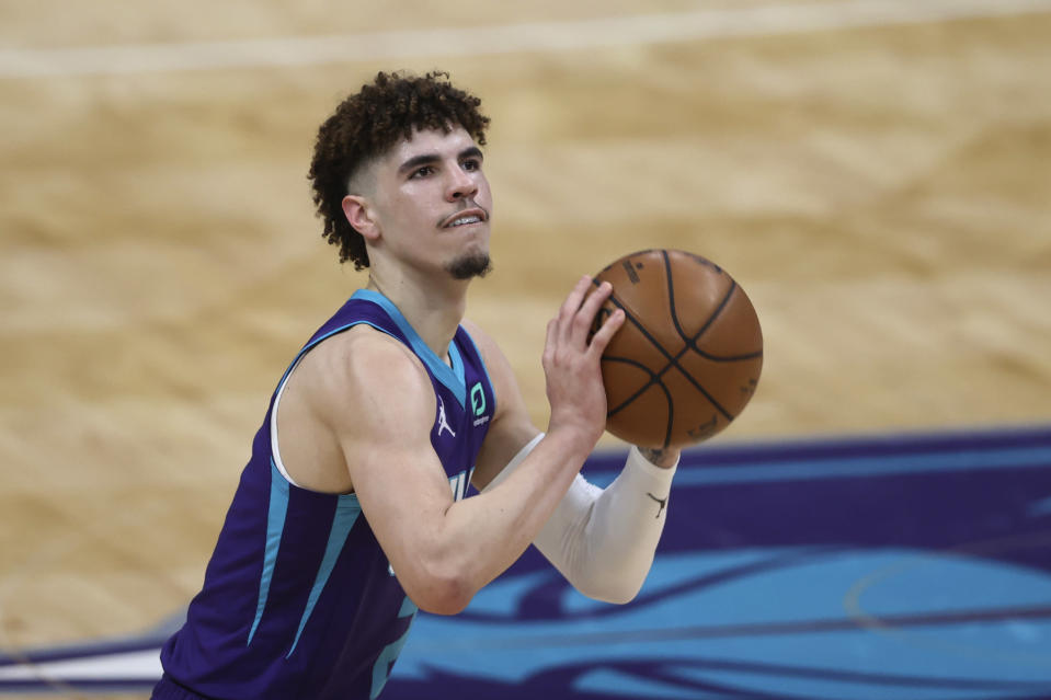 Charlotte Hornets guard LaMelo Ball shoots against the Orlando Magic during the first half of an NBA basketball game in Charlotte, N.C., Friday, May 7, 2021. (AP Photo/Nell Redmond)